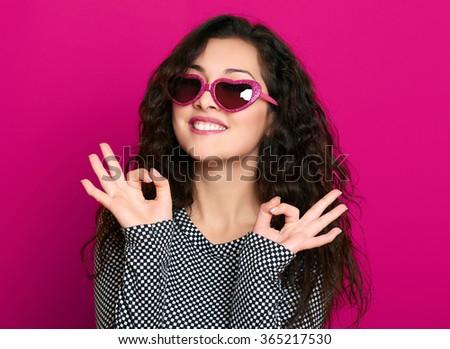 beautiful girl glamour portrait on pink show okay gesture - stock photo