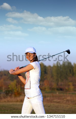 beautiful girl golf player on field - stock photo