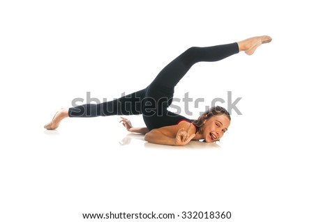 Beautiful girl gymnast sitting on a floor and looking at camera, isolated on white background - stock photo