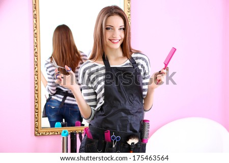 Beautiful girl hairdresser in beauty salon - stock photo