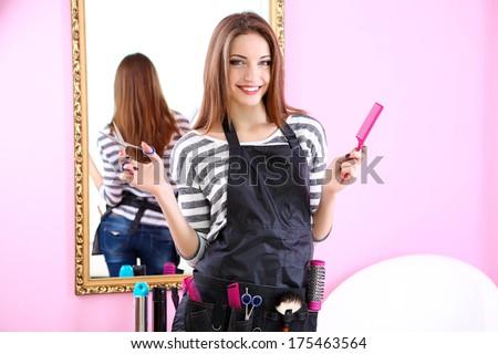 Beautiful girl hairdresser in beauty salon