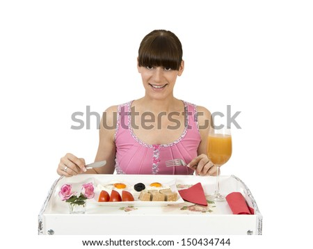 Beautiful girl having breakfast in bed...Feel free to check my other similar photos...