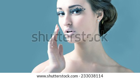 Beautiful Girl. Healthy Hair and Holiday Makeup. False eyelashes in the form of butterflies. - stock photo