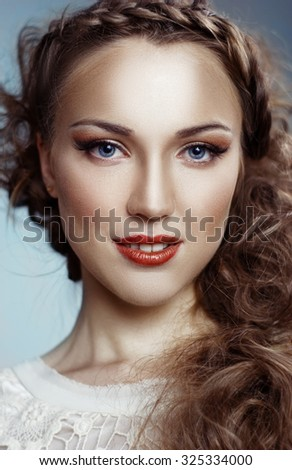 Beautiful Girl. Healthy Long Curly Hair with blue ribbon - stock photo