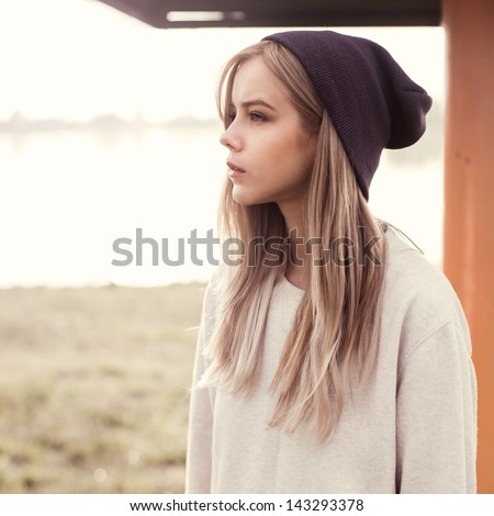 beautiful girl hipster in the morning on the beach - stock photo