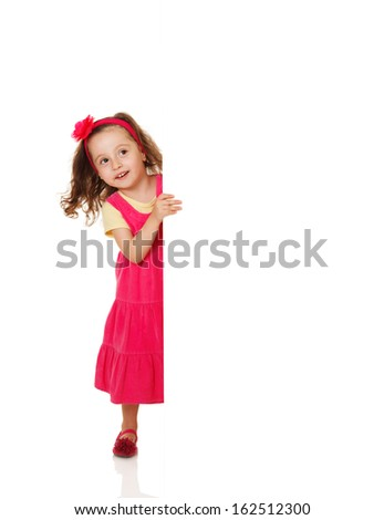Beautiful girl holding a blank placard - stock photo