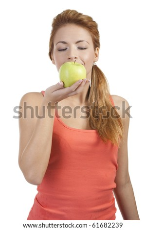 Beautiful girl holding a fresh green healthy apple