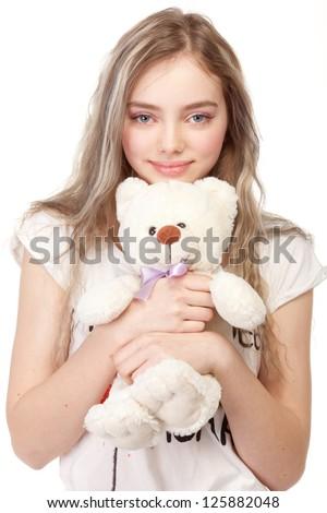 Beautiful girl holding a teddy bear. - stock photo
