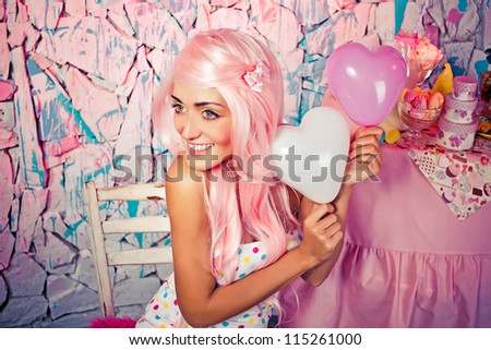 Beautiful girl holding balloons in form of hearts - stock photo