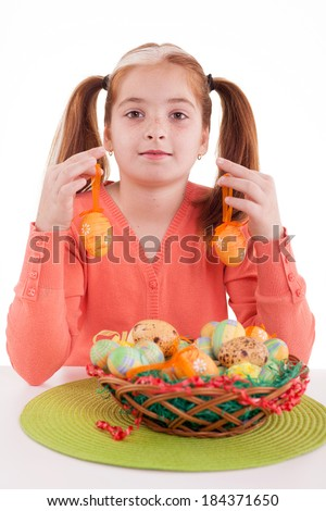 Beautiful girl holding Easter eggs