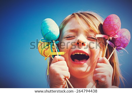 Beautiful girl holding Easter eggs - stock photo