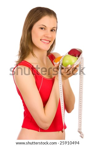 Beautiful girl holding fruits and a measure tape; isolated on white