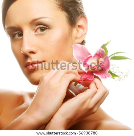 Beautiful girl holding orchid flower in her hands