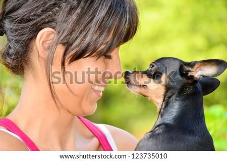 beautiful girl hugging little dog - stock photo