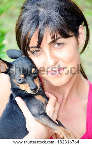 beautiful girl hugging little dog outdoor