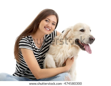 Beautiful girl hugging retriever, isolated on white