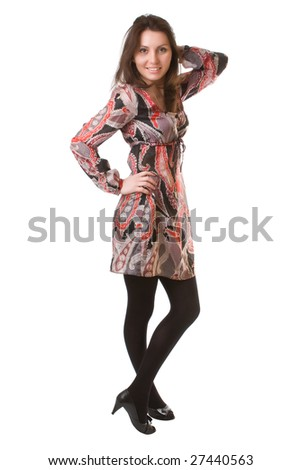 Beautiful girl in a bright motley dress isolated on a white background