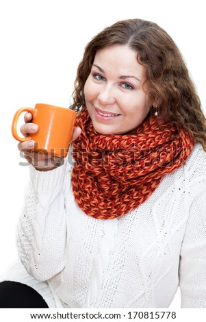 Beautiful girl in a bright scarf with cup coffee in hand, isolated on white background - stock photo