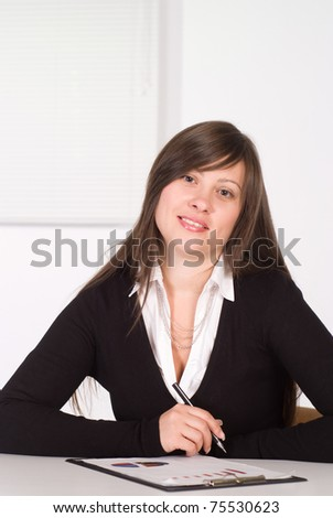 beautiful girl in a business suit working in the office - stock photo
