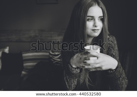 beautiful girl in a cafe drinking coffee - stock photo