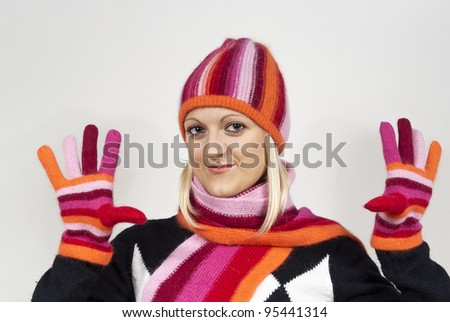 beautiful girl in a cap on the background - stock photo