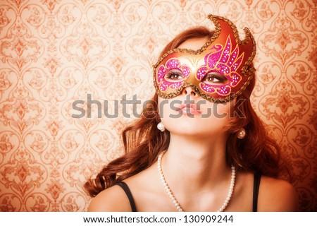 Beautiful Girl in a Carnival mask - stock photo
