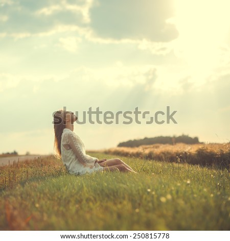 beautiful girl in a dress greeted the dawn - stock photo