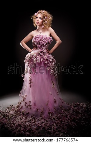 beautiful girl in a dress of flowering branches - stock photo