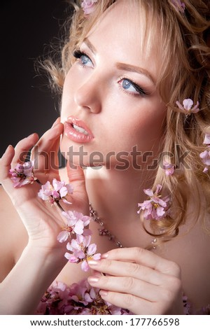 beautiful girl in a dress of flowering branches