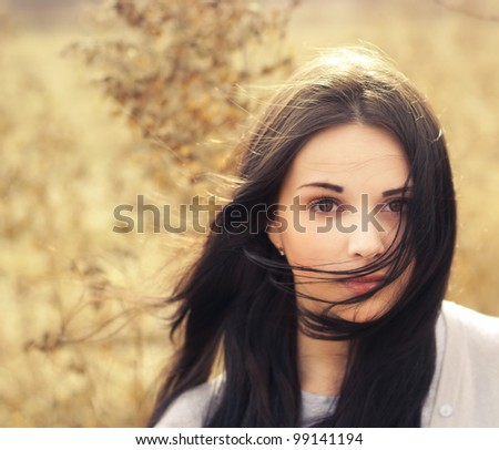 beautiful girl in a field - stock photo