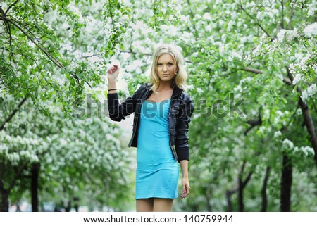 Beautiful girl in a flowering apple trees
