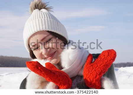 beautiful girl in a fur coat in the winter
