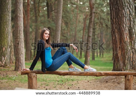 Beautiful Girl in a park, look to camera