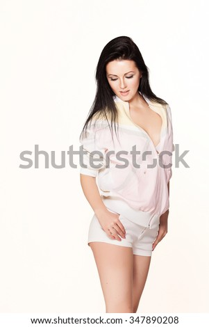 Beautiful girl in a pink tracksuit. - stock photo