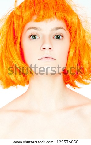 beautiful girl in a red wig - stock photo