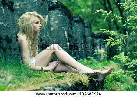 beautiful girl in a sad posture - stock photo