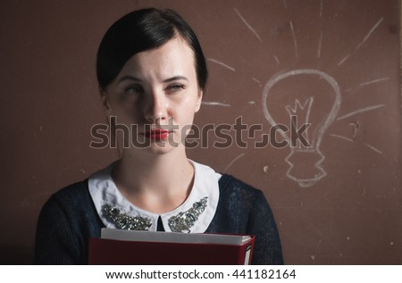 beautiful girl in a strict fashion with  folder in hand - stock photo