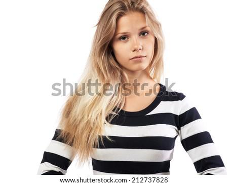 beautiful girl in a striped sweater tired - stock photo