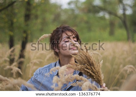 Beautiful girl in a summer field