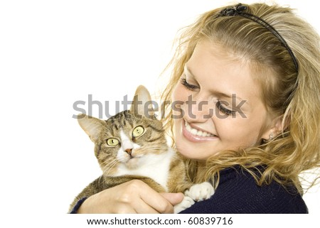 Beautiful girl in a sweater keeps on hand a cat. Lots of copyspace and room for text on this isolate - stock photo