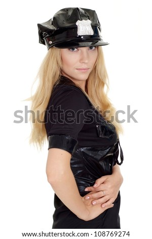 Beautiful girl in a uniform of  police officer on a white background