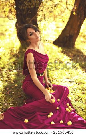 Beautiful girl in autumn garden - stock photo