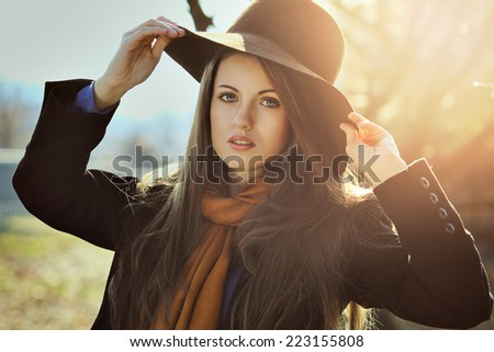 Beautiful girl in autumn light portrait . Seasonal outdoor - stock photo