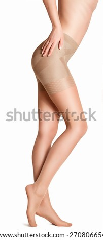 Beautiful girl in beige tights. Isolated on white background - stock photo