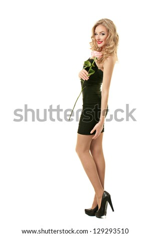 Beautiful girl in black dress standing with rose