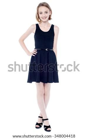 Beautiful girl in black sleeveless dress - stock photo