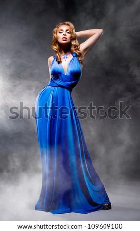 Beautiful girl in blue evening dress - stock photo