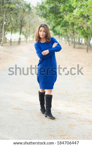 Beautiful girl in blue show fashion concept
