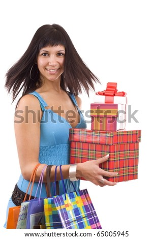 Beautiful girl in blue with group gift box. Isolated.