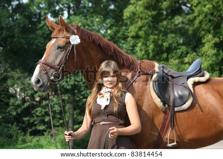 Beautiful girl in brown dress and brown horse